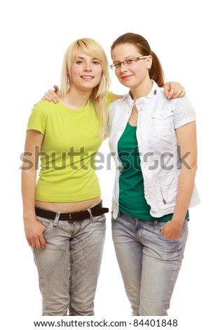 Two happy girls isolated on white - stock photo