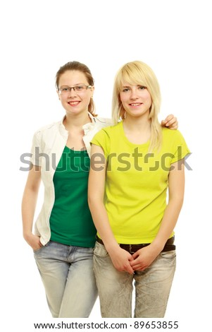 Two happy girls isolated on white background