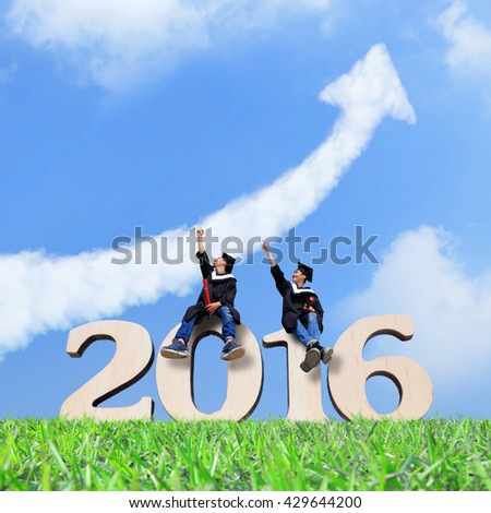 Two happy graduates student look sky and pointing something, asian - stock photo