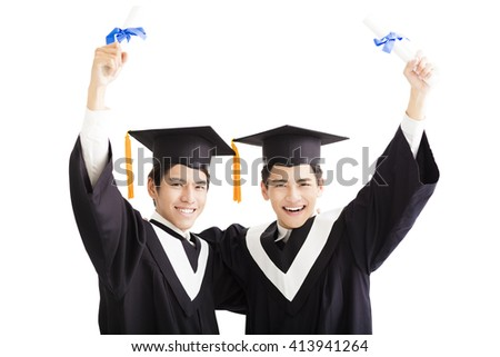 Two happy graduating students isolated on white - stock photo
