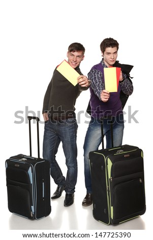 Two happy guys tourist in full length standing with suitcases showing you blank cards with copy space, against white background - stock photo