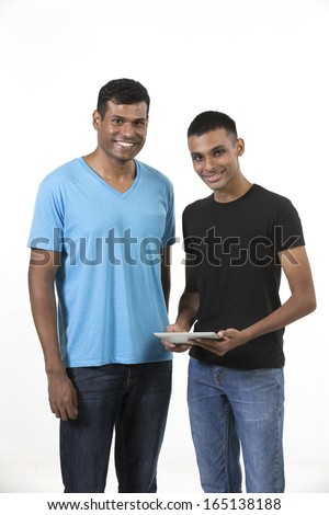 Two happy Indian male friends. Isolated on a white background.