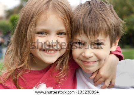 two happy kids hugging