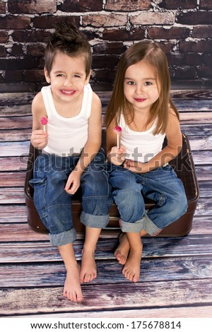 Two happy kids in studio - stock photo
