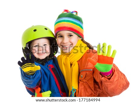 Two happy kids in winter overalls standing together, isolated on white - stock photo