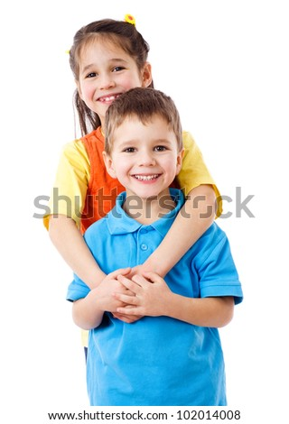Two happy kids standing together, isolated on white - stock photo