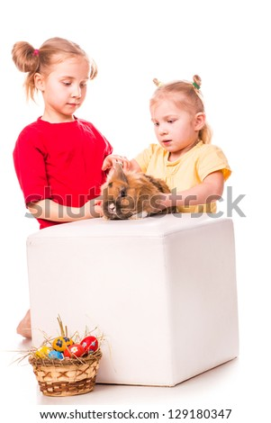 Two happy kids with easter bunny and eggs isolated on white. Happy Easter