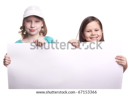 two happy little girls with a blank sheet of paper