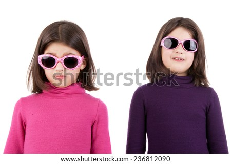 two happy little twin sisters in the sunglasses - stock photo