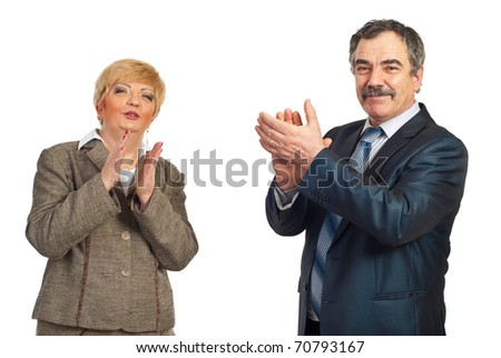 Two happy mature business people applauding isolated on white background