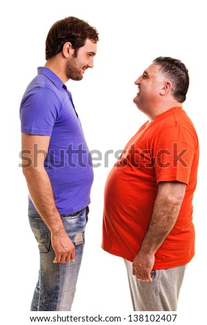 Two happy men standing face to face isolated on white background