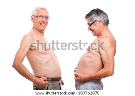 Two happy naked senior men comparing belly, isolated on white background.
