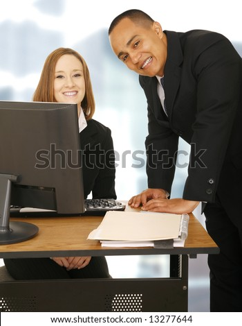 two happy office worker staying in office, both looking at camera. concept for business team, team work