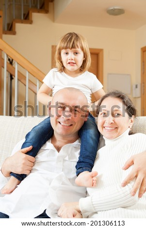 two happy parents with daughter