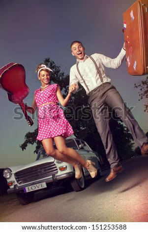 Two happy people embark on a journey - stock photo