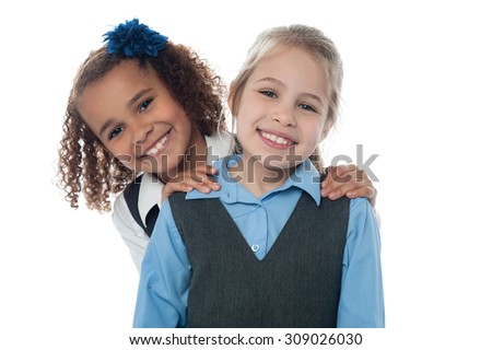 Two happy school girls isolated on white - stock photo