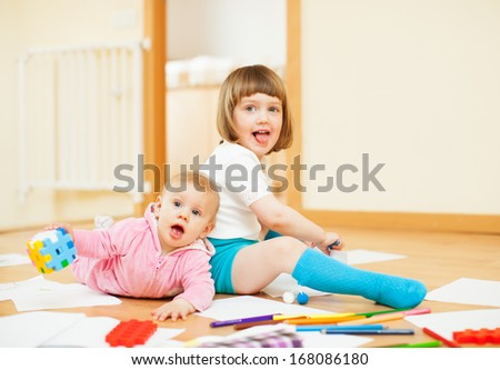 Two happy siblings together in home interior