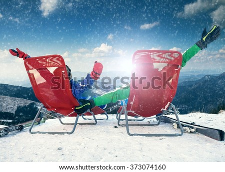 Two happy skiers on the top of mountain  - stock photo