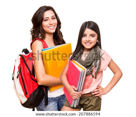 Two happy students posing over white background - stock photo