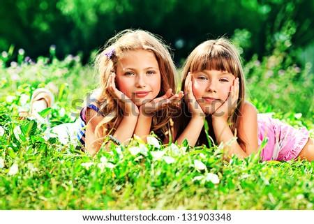Two happy summer girls having fun outdoors. - stock photo
