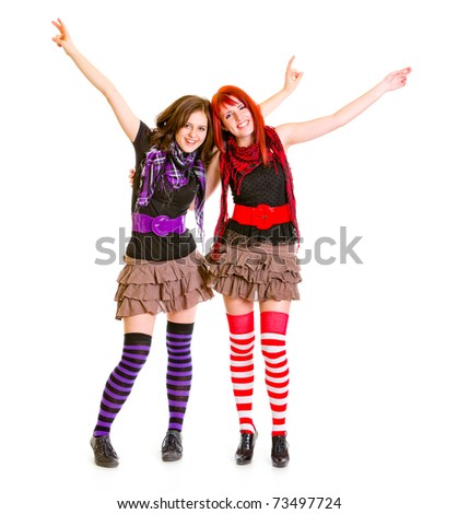 Two happy teen girlfriends embracing each other isolated on white - stock photo