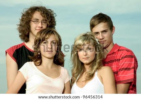 two happy teenage couples - stock photo
