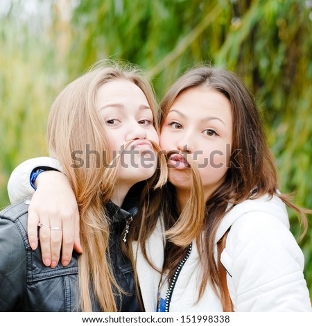 Two happy teenage girl friends - stock photo