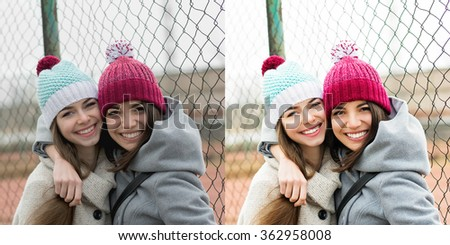 Two happy teenage girlfriends hugging and smiling wearing coats and colorful knitted beanie hats. Two shots, before and after retouch, color correction and filter. - stock photo