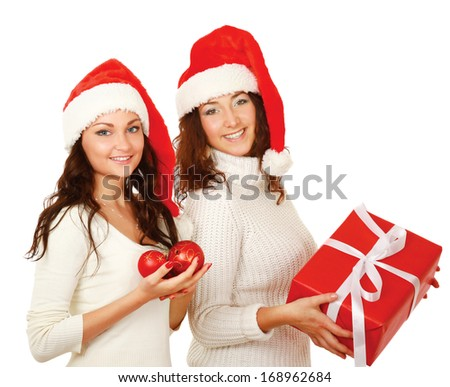 Two happy women in santa has with gift boxes standing on white background isolated. - stock photo
