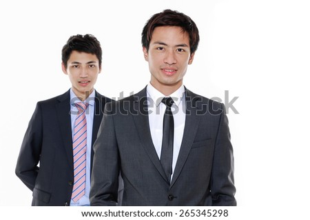 Two happy young businessmen - stock photo