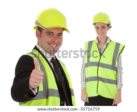Two happy young engineers are smiling about some sort of achievement - stock photo