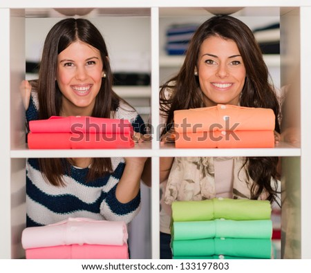 Two Happy Young Female Friends Shopping
