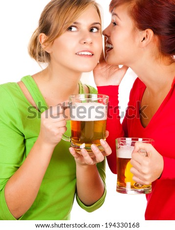 Two happy young girlfriends talking over white.  - stock photo