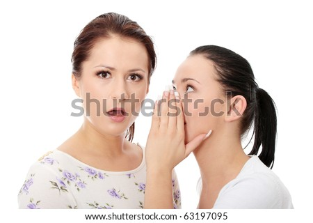 Two happy young girlfriends talking over white - stock photo