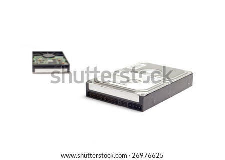 Two hard disk drives isolated on white.