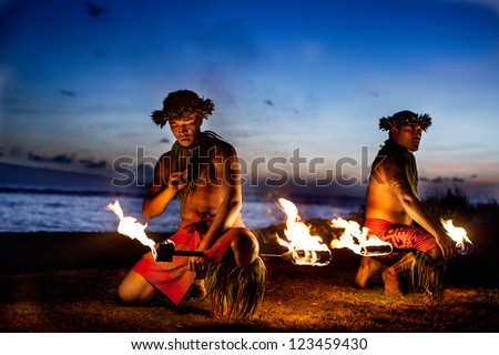 Two Hawaiian Men preparing to Dance with Fire in Maui - stock photo