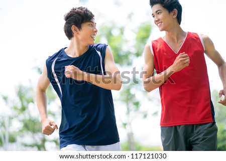 Two healthy boys jogging in the morning - stock photo