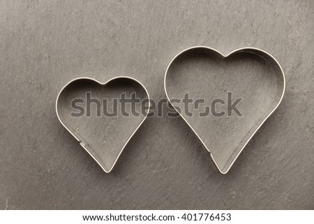 two heart cookie cutter on slate