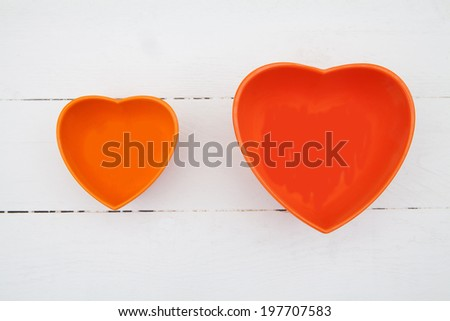 Two heart object on a white wood table