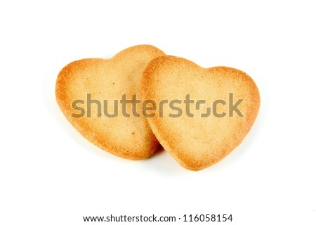 two heart shaped cookies made �¢??�¢??with natural ingredients on white background - stock photo