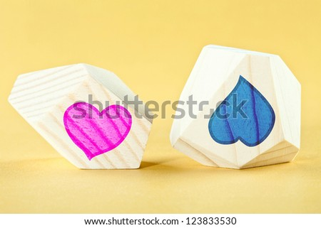 Two heart-shaped pictures illustrating opposite feelings - sympathy and antipathy (like and dislike, love and hate) - stock photo
