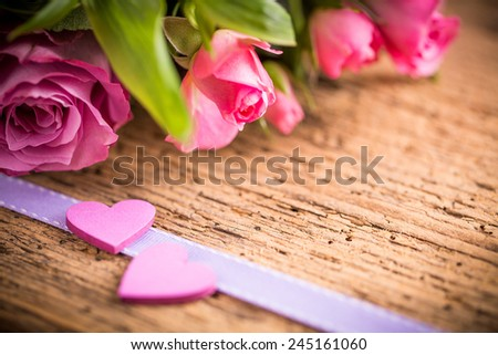 two hearts and a bouquet of roses - stock photo