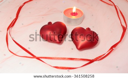 Two hearts candle and ribbon decoration for Valentine's Day - stock photo