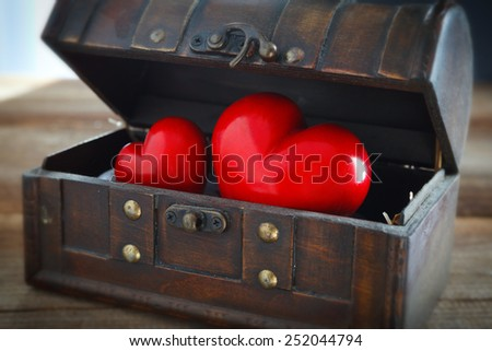 two hearts in a treasure chest - stock photo