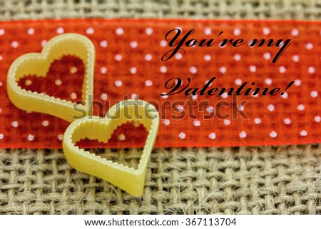 Two Hearts lie on a cloth - stock photo
