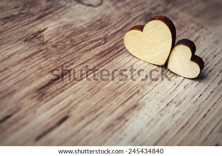 two hearts on a wooden surface - stock photo