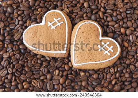 Two hearts on coffee background. Valentine's day concept. Love concept - stock photo