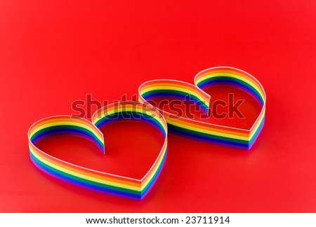 Two hearts, paint  of a six-colour gay symbolic colours. - stock photo
