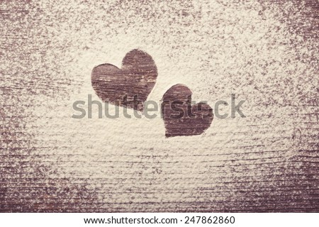 Two Hearts shape silhouette made from snow with copyspace - stock photo
