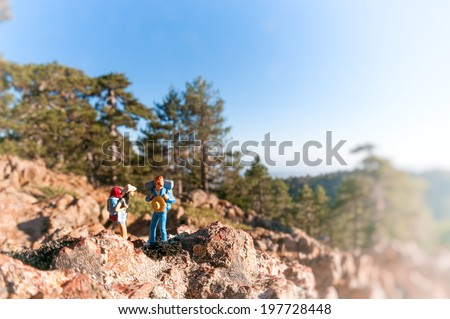 Two hikers in mountains. Macro photography - stock photo